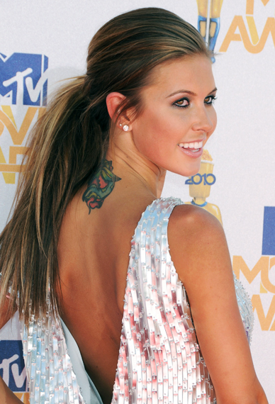 You don't often see Audrina Patridge's tattoo because it's on the back of ...