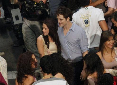 Kristen Stewart and Robert Pattinson are seen here, on the set of Breaking