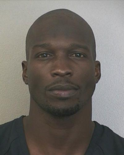 chad johnson ochocinco mug shot 401x502 Chad Johnson Arrested For Domestic Violence, Accused of HEAD BUTTING Evelyn Lozada