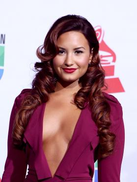 Demi Lovato Shocks, Sings at Latin Grammys