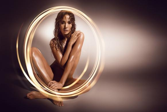 Jennifer Lopez poses naked in this fragrance ad.