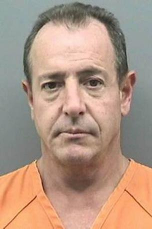 michael lohans mug shot 304x457 Michael Lohan Charged With All Sorts of Crimes