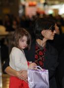 mother and doll 130x179 - SuRi CrUisE (Tom Crusie's Daughter)