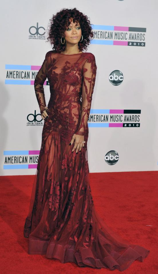Red, Curly Rihanna. What do you think of Rihanna's dress and hair at the