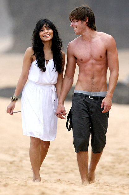 Shirtless Zac Efron and Vanessa Hudgens. Zanessa heats up a Hawaiian beach.